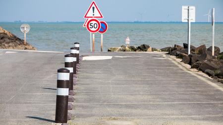 black flexible bollard with traffic zebra next to sea