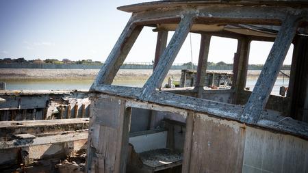 devastation: Rustic boats on a ship graveyards on Noirmoutier, France