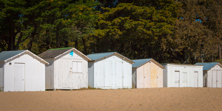 beach huts: old white beach huts of Noirmoutier, France