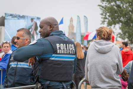 euro area: Saint Gilles Croix de Vie, France - July, 10, 2016 : In the fan zone of the city, municipal police monitor and search visitors to the fan area of the city came to watch the final match of Euro 2016, France - Portugal
