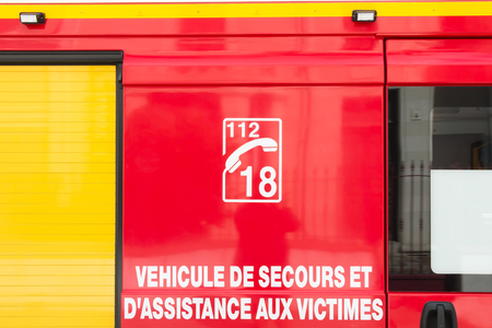 emergency vehicle: Emergency vehicle and assist victims with emergency phone numbers