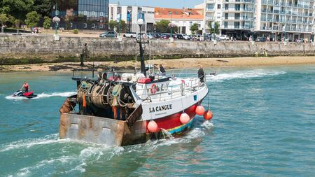 les Sables d Olonne, France - July 24, 2016 : a fishing boat returns to port