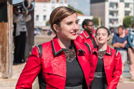 fanfare: Saint Gilles Croix de Vie, France - July 14, 2016 : portait of fanfare dancing girl in the street that accompanies the musicians during the day of the French national day Editorial