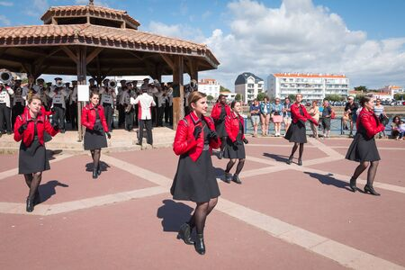 Saint Gilles Croix de Vie, France - July 14, 2016 : set of dancers accompanying a fanfare at the French National Day