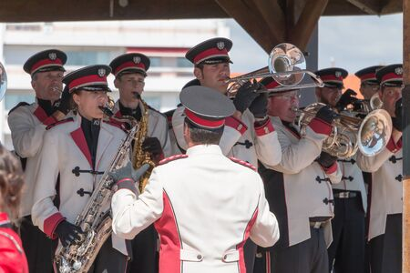 fanfare: Saint Gilles Croix de Vie, France - July 14, 2016 : fanfare band playing in a kiosk for the French National Day