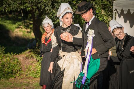 troupe: Brem sur Mer, France - July 09, 2016 : couple married for a show of traditional dance troupe Vendee region of France, celebrating a wedding