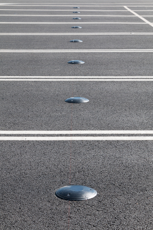 indicate: Electromagnetic car parking sensor to indicate where open parking is located on city streets Stock Photo