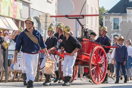 plunges: Challans, France - August 11, 2016 : event Once Challans Autrefois Challans organized by the city and plunges visitors into the city from the early 20th century - antique firefighters to intervene with a water pump