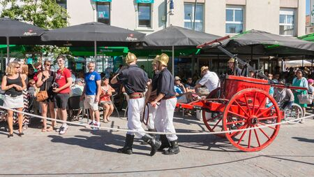 Challans, France - August 11, 2016 : event Once Challans Autrefois Challans organized by the city and plunges visitors into the city from the early 20th century - antique firefighters to intervene with a water pump
