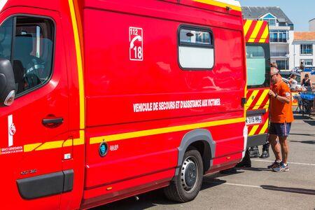 Saint Gilles Croix de Vie, France - August 14, 2016 : intervention of a fire truck after the discomfort of a man in the port of Saint Gilles Croix de Vie, France