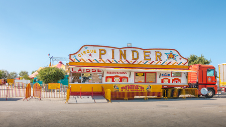 Noirmoutier, France - August 15, 2016 : installing the Pinder circus in a parking lot of Noirmoutier, France, during the summer 2016 - ticketing of circus Pinder Editorial