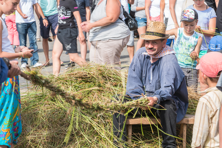 plunges: Challans, France - August 11, 2016 : event Once Challans Autrefois Challans organized by the city and plunges visitors into the city from the early 20th century - men manufacturing rope in the old-fashioned way
