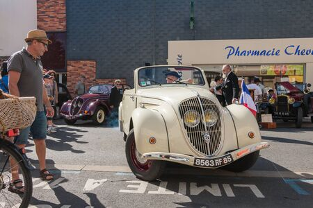 Challans, France - August 11, 2016 : event Once Challans Autrefois Challans organized by the city and plunges visitors into the city from the early 20th century - presentation in the street of old vintage cars