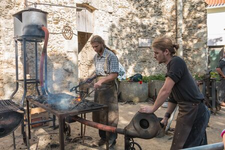 Challans, France - August 11, 2016 : event Once Challans Autrefois Challans organized by the city and plunges visitors into the city from the early 20th century - demonstration by two blacksmiths labor metal to the old way
