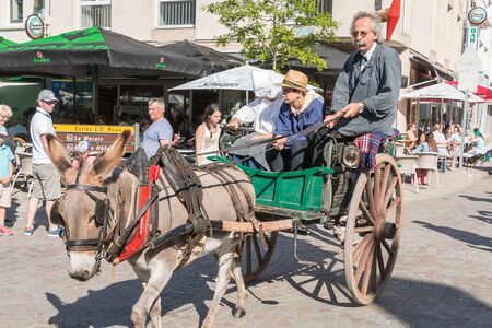 Challans, France - August 11, 2016 : event Once Challans Autrefois Challans organized by the city and plunges visitors into the city from the early 20th century - antique cart pulled by a donkey in the streets of the city Editorial