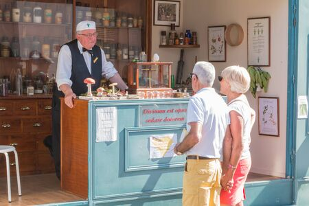 plunges: Challans, France - August 11, 2016 : event Once Challans Autrefois Challans organized by the city and plunges visitors into the city from the early 20th century - reproduction of a traveling pharmacy with pharmacist