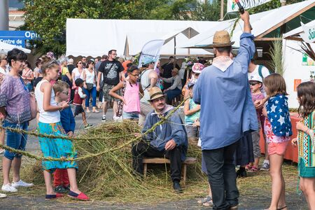 Challans, France - August 11, 2016 : event Once Challans Autrefois Challans organized by the city and plunges visitors into the city from the early 20th century - men manufacturing rope in the old-fashioned way