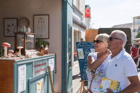 hippocrates: Challans, France - August 11, 2016 : event Once Challans Autrefois Challans organized by the city and plunges visitors into the city from the early 20th century - reproduction of a traveling pharmacy with pharmacist