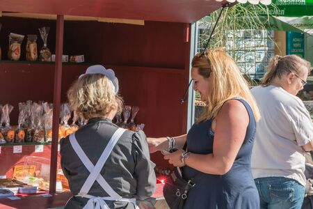 plunges: Challans, France - August 11, 2016 : event Once Challans Autrefois Challans organized by the city and plunges visitors into the city from the early 20th century - saleswoman ancient confectioneries with trailer