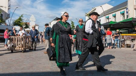Challans, France - August 11, 2016 : event Once Challans Autrefois Challans organized by the city and plunges visitors into the city from the early 20th century - group of people dressed in period clothes