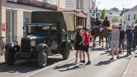 plunges: Challans, France - August 11, 2016 : event Once Challans Autrefois Challans organized by the city and plunges visitors into the city from the early 20th century - men dressed as police officer with period costumes Editorial