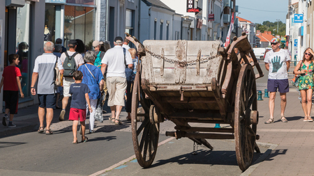 plunges: Challans, France - August 11, 2016 : event Once Challans Autrefois Challans organized by the city and plunges visitors into the city from the early 20th century - old horse trailer on display in the city