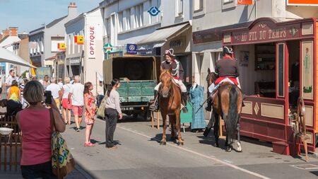 Challans, France - August 11, 2016 : event Once Challans Autrefois Challans organized by the city and plunges visitors into the city from the early 20th century - men dressed as police officer with period costumes Editorial