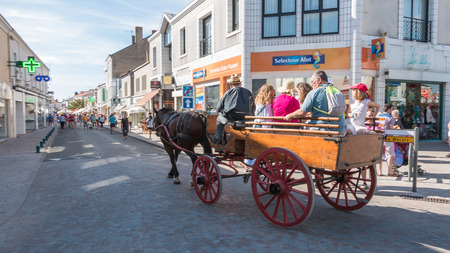 horse pull: Challans, France - August 11, 2016 : event Once Challans Autrefois Challans organized by the city and plunges visitors into the city from the early 20th century - antique cart pulled by a horse in the streets of the city