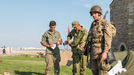 reconstituted: Les Sables dOlonne, France - August 26, 2016 : commemoration of the Liberation of Les Sables dOlonne, which took place on the night of August 27 to 28, 1944 - American and Russian soldiers relax in a reconstituted military camp