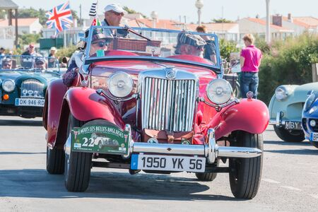 Sables d Olonne, France  - September 23, 2016 : English vintage car rally in the streets of the city, A Nous les Belles Anglaise - parade of beautiful old English cars Editorial