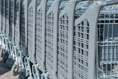 caddie: Wire modern supermarket shopping cart, symbol of consumerism in france