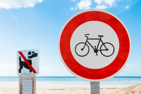 prohibits bikes sign and  prohibits dogs sign in the beach Stock Photo