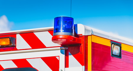 blue flashing light on a red ambulance firefighters