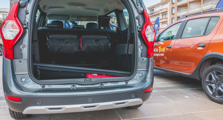 the throughout: Sables d Olonne, France - May 07, 2017: Dacia Tour 2017 is a commercial operation organized by the car builder in order to present its cars throughout France - Close-up on cars