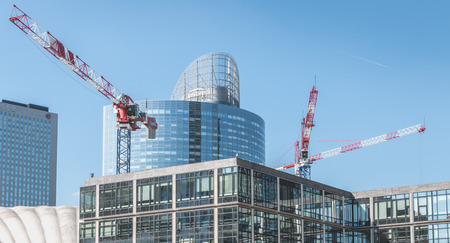 Nanterre, FRANCE, May 09, 2017 - Crane who are working on the construction of new buildings in the Defense business district, in Paris Editorial
