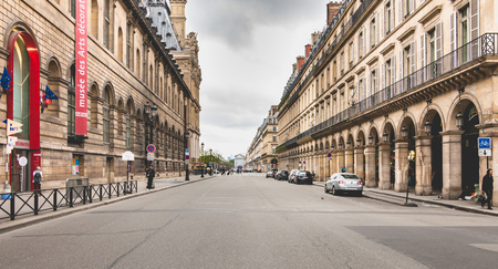Paris, FRANCE, May 08, 2017 - Atmosphere of the typical rue de Rivoli in Paris, France, empty, a day of spring under the gray clouds