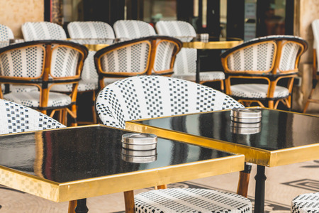 grunge cutlery: Traditional Parisian terrace with tables, chairs and ashtrays Stock Photo