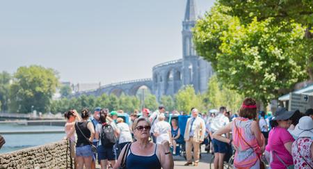 Lourdes, FRANCE, June 22, 2017 - pilgrims heading towards the miraculous water pools of Lourdes, France