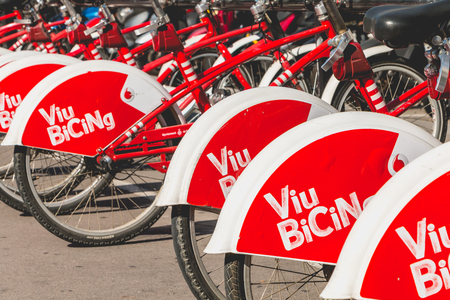 shared sharing: BARCELONA, SPAIN - june 20, 2017: Service Vehicles bicycles Vodafone Bicing. Bicing is the name of a bicycle sharing system in Barcelona inaugurated on March 22, 2007.