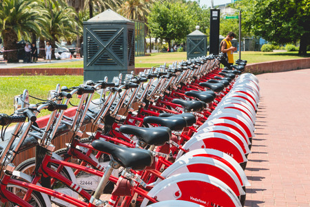 BARCELONA, SPAIN - june 21, 2017: Service Vehicles bicycles Vodafone Bicing. Bicing is the name of a bicycle sharing system in Barcelona inaugurated on March 22, 2007.
