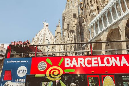 BARCELONA, SPAIN - June 21, 2017 : A tourist bus is parked in front of the Sagrada Familia, a wide Roman Catholic church designed by Catalan architect Antoni Gaudi Editorial
