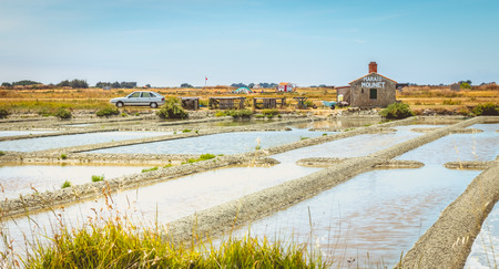 salinity: NOIRMOUTIER, FRANCE - July 03, 2017 : Small shop on the roadside where one can buy salt harvested directly in salt marshes