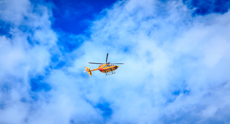 Paris, FRANCE - july 11, 2017: Helicopter EC 135 of the Civil Security flying over the French capital in order to train for the parade on 14 July, the day of the French national holiday Editorial