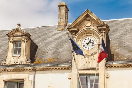 NOIRMOUTIER, FRANCE - July 03, 2017 : architecture detail of the town hall of Noirmoutier, France with its clock