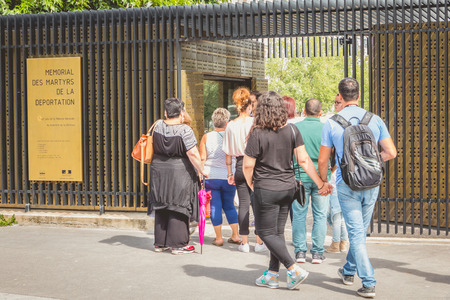 jewish star: PARIS, FRANCE - July 07, 2017 : entered the memorial of the martyrs of deportation in Paris, France, where queuing tourists Editorial