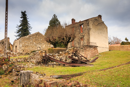 ORADOUR SUR GLANE, FRANCE - December 03, 2017 : ruined house destroyed by fire following the massacre of the entire population by the German army on June 10, 1944. The village has become a symbol and has remained in the state since that date Editorial