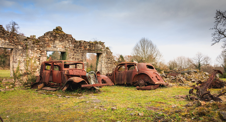 ORADOUR SUR GLANE, FRANCE - December 03, 2017 : remains of a burnt car remained in the state since the massacre of the population by the German army on June 10, 1944
