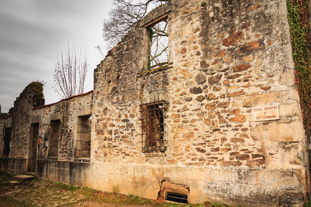 ORADOUR SUR GLANE, FRANCE - December 03, 2017 : remains in ruins of the childrens school and Lorrainers destroyed by the fire during the massacre of the population on June 10, 1944