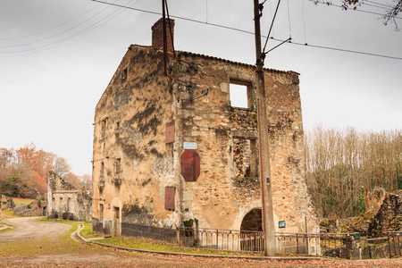 ORADOUR SUR GLANE, FRANCE - December 03, 2017 : in the village streets, remains in ruins of houses destroyed by fires during the massacre of the population by the German army at the end of World War II Editorial