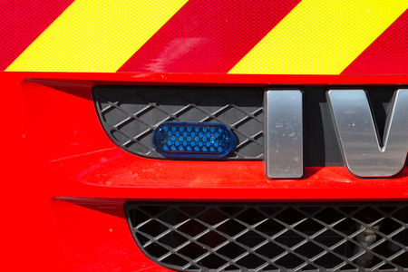 SAINT GILLES CROIX DE VIE, FRANCE - July 13, 2016 : blue flash light in the front of a fire truck during a hardware show on firefighters' day Stock Photo - 93494814